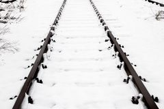 Train rails, track covered with snow during winter. Railway covered with fresh white snow. Transportation Stock Photos