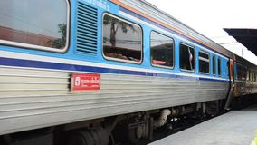 Train on railway at Bangpa-in Station in Ayutthaya Thailand stock video
