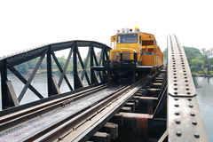 Train on railway bridge Stock Photography