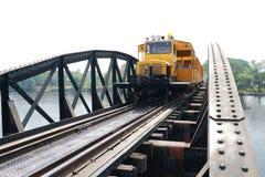 Train on railway bridge. Cross river Stock Photography