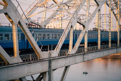 Train on the railway bridge across Dnepr river Royalty Free Stock Images