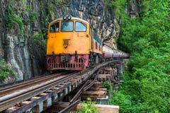 Train into the Railway bridge. At Kanchanaburi Stock Photo