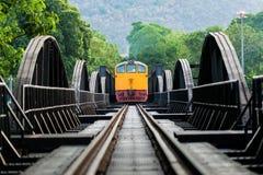 Train into the Railway bridge. At Kanchanaburi Stock Photography