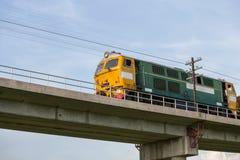 Train on the railway bridge Stock Photos