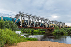 Train. Railway bridge over the river Volchina royalty free stock images