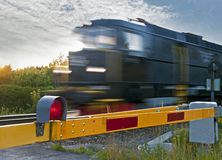 Train at railway crossing Stock Images