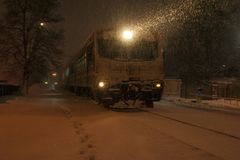 Passenger train moves on the railway in winter in Ukraine. royalty free stock photo