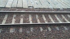 Train railway. Metalic train rail lines with rocky texture Stock Photo