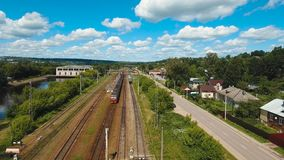 Train on the railway. Passenger train on a railway in a rural country. Aerial view train, railway, highway. Aerial drone footage, 4k stock video footage