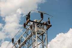Train or railway power line support. Railway power lines with high voltage electricity on metal poles against blue sky. Communication and transmission royalty free stock photo