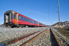 Train at the railway station. The train standing at the Halden railway station, waiting for passengers Stock Photos