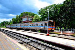 Train at railway station Stock Images