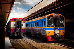 Train by the railway station Royalty Free Stock Photos