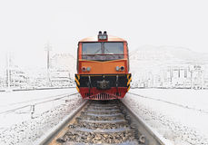 Train by the railway station Royalty Free Stock Image