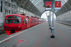 Train on the railway station. Train on the covered railway station. Moscow Stock Photo