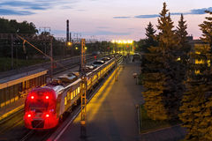 Train on railway station at night Royalty Free Stock Image