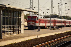 Train on the railway station. Traditional train with electric locomotive on Vilnius railway station, in Lithuania Royalty Free Stock Images