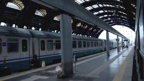Train in railway station. View of railway station. Train leaving the city stock footage