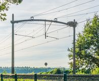 Train railway with a stork bird nest and power cables. A Train railway with a stork bird nest and power cables royalty free stock images