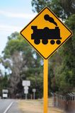 Train railway traffic sign. Traffic sign indicating oncoming railway line and train Stock Photography