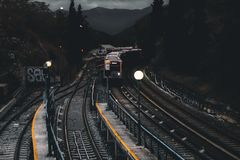 Train on Railways during Nighttime Stock Image