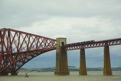 Train on the Red Bridge, Edinburgh, Scotland, UK. Royalty Free Stock Photo