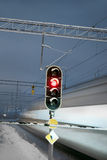 Train and red signal at railway crossing Stock Photos
