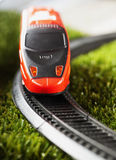 Train. Red toy train running over railroad Stock Images