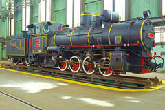 Train. Restored old locomotive in the factory,photography Royalty Free Stock Photo