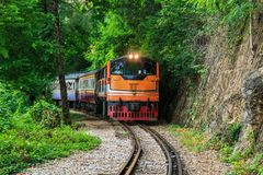 Train is ridden along the mountain. And through the tunnel for tge tourism in Kanchanaburi province of Thailand Royalty Free Stock Photos