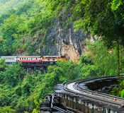 Train is ridden along the mountain. And through the tunnel for tge tourism in Kanchanaburi province of Thailand Stock Photography
