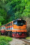 Train is ridden along the mountain. And through the tunnel for the tourism in Kanchanaburi province of Thailand Royalty Free Stock Photo