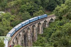 Train on Nine Arches bridge in hill country of Sri Lanka Stock Images