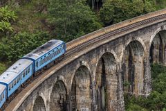 Train on Nine Arches bridge in hill country of Sri Lanka Royalty Free Stock Image