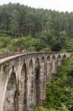 Nine Arches bridge in hill country of Sri Lanka. The train ride through hill country from Kandy to Ella is one of the most beautiful travels by train in the Royalty Free Stock Photo