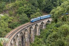 Train on Nine Arches bridge in hill country of Sri Lanka. The train ride through hill country from Kandy to Ella is one of the most beautiful travels by train in Royalty Free Stock Images