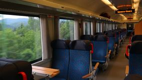 Train ride interior. Interior of a passenger train with empty seats stock footage