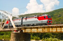 Train rides over bridge Stock Photos