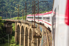 Train rides through the picturesque bridge Royalty Free Stock Images