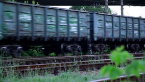 Train Rides on Rails. Laden Train Rides on Iron Rails. Pulls a Big Load stock footage