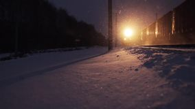 Train rides in the winter. Novosibirsk region, Russia - December 4, 2015: Locomotive lights snow. Trans-Siberian Railway. Full HD Resolution 1920×1080 Video stock footage
