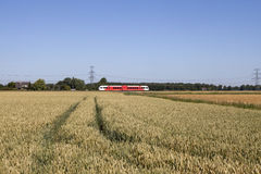 Train riding through landscape Royalty Free Stock Image