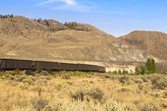 Train rolling across the grasslands Stock Photos