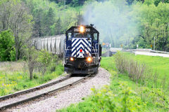 Train rounding the bend. A Blue train rolling throught the country side Stock Image