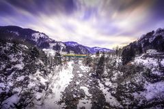 The train route from Chigaki Station has snow covered in winter. Toyama region railway Tateyama line, crossing the iron bridge bet royalty free stock images