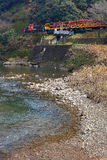 Train running on Arashiyama river, Kyoto, Japan. Train is running on Arashiyama river, Kyoto, Japan Royalty Free Stock Images