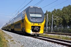 Train running in the countryside of Netherlands. Train running in the countryside of the Netherlands Stock Photos