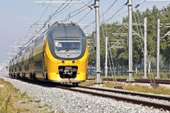 Train running in the countryside of Netherlands Stock Photography