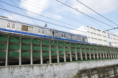 Train running from Ikebukuro railway station go to Shin okubo su. Bway station in Shinjuku city of Kanto region in Tokyo, Japan Stock Image