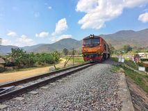 Train running on metal railway with the moutian landscape countryside Royalty Free Stock Images